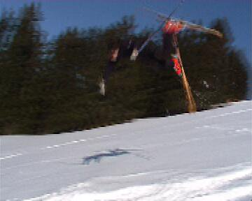 Trying the front flip, but eating the snow. It hurts................
