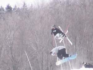 going huge over a snowboarder with a mute