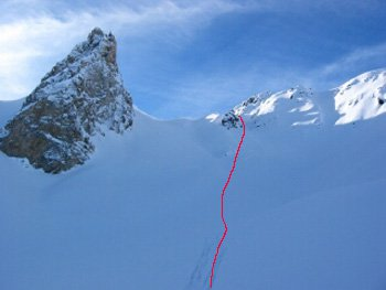 Showing my line through the small gully onto the open face. The snow was AWESOME thigh deep