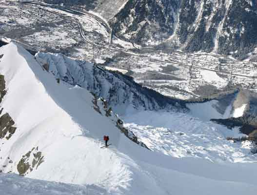 You have to ski out to the left into a steep exit couloir to avoid the large ice cliff