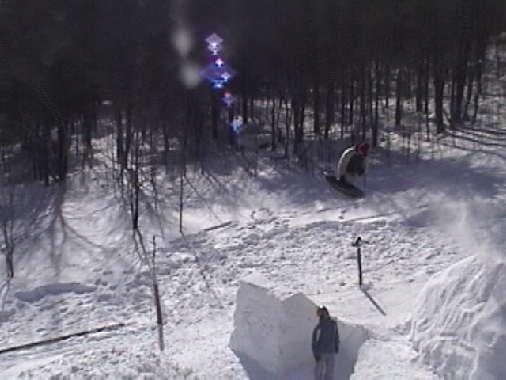 little backyard sled jump over some kids