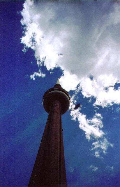 CN tower with the sun peekin threw the clouds