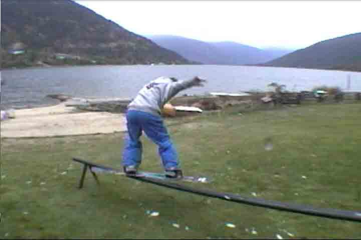 boardslide on rail we set up in my yard.
