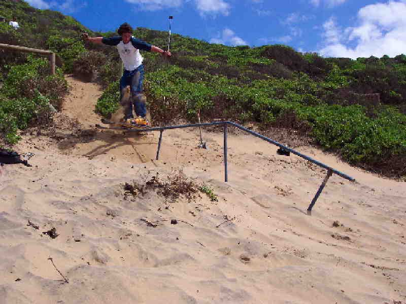 Sand skiing to flat down rail