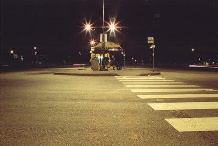 A bus loop in Ladner at night.