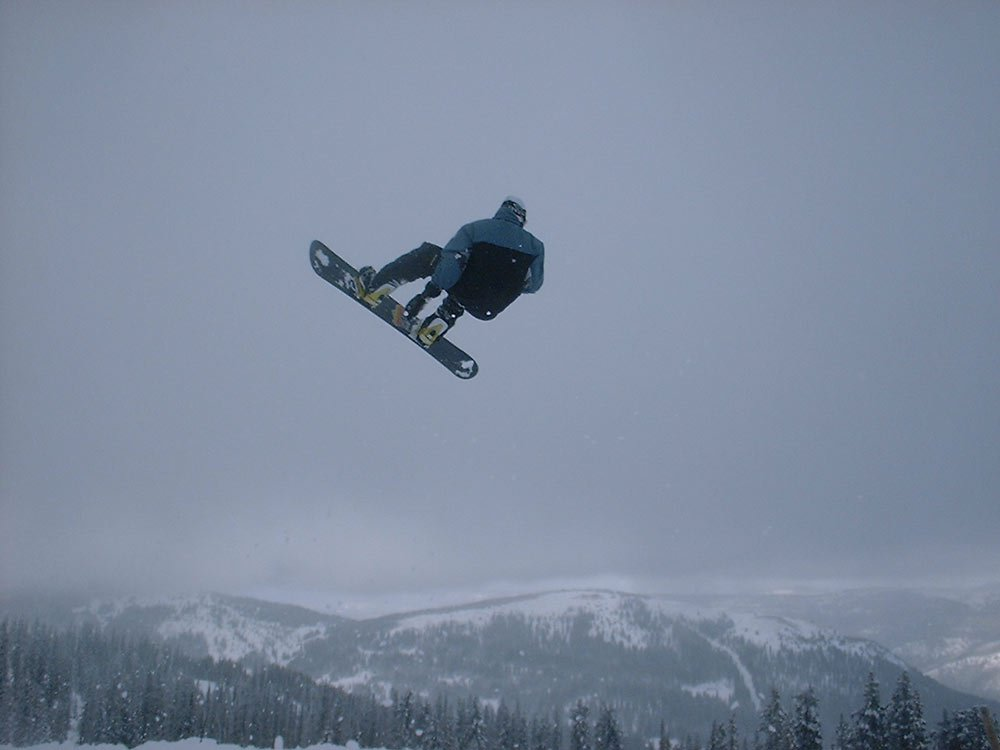 a snowboarder going big