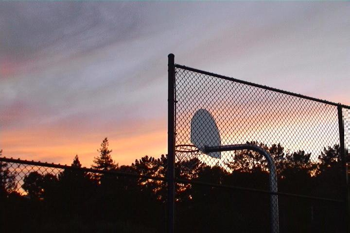 Basketball hoop and sunset
