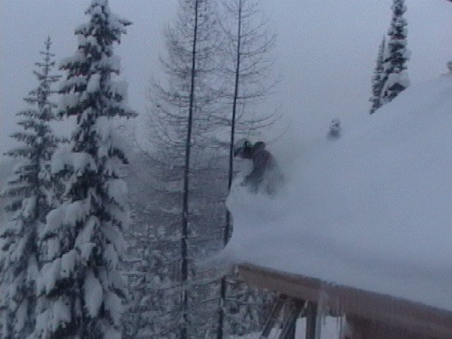skiing off a rrof