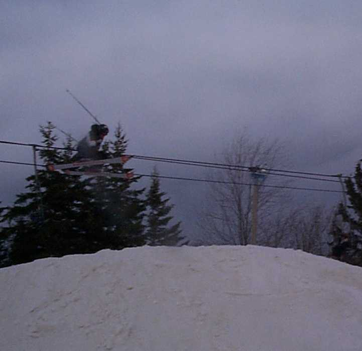 Andrew grabbin his skies