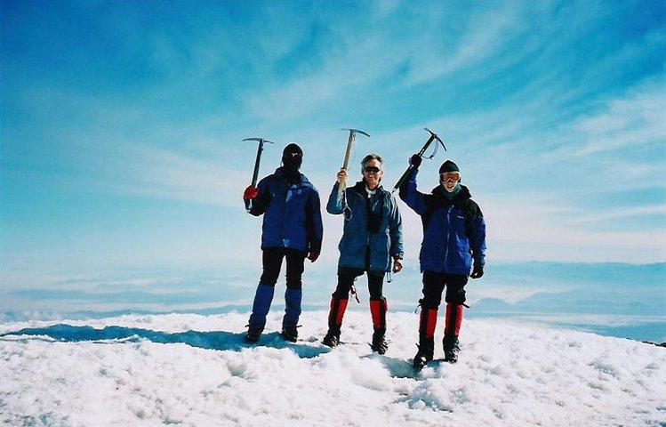 standing at 14,411 feet ( Mt Rainier summit )