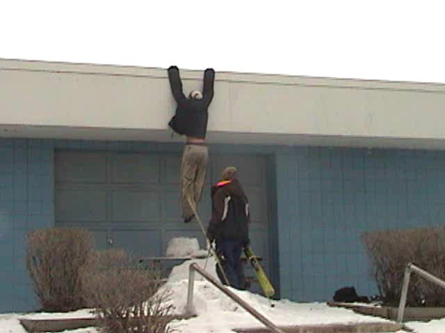 Hanging from swimming pool building