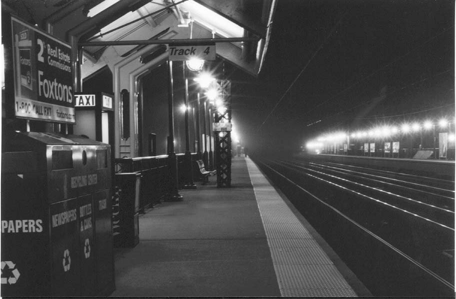 guy in the distance at the train station