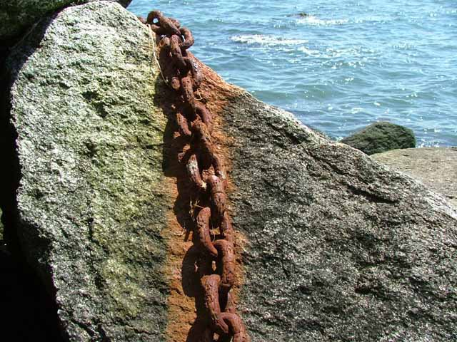 Rusty chain by the ocean