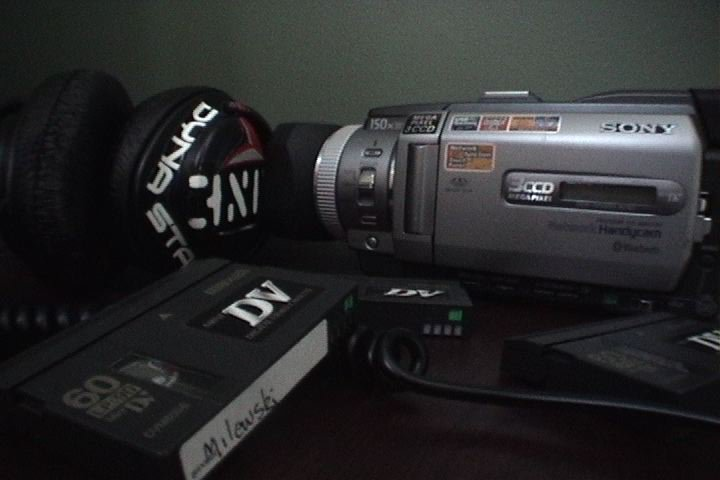 one of my cameras, headphones, and DVmini tapes I though it looked kinda cool