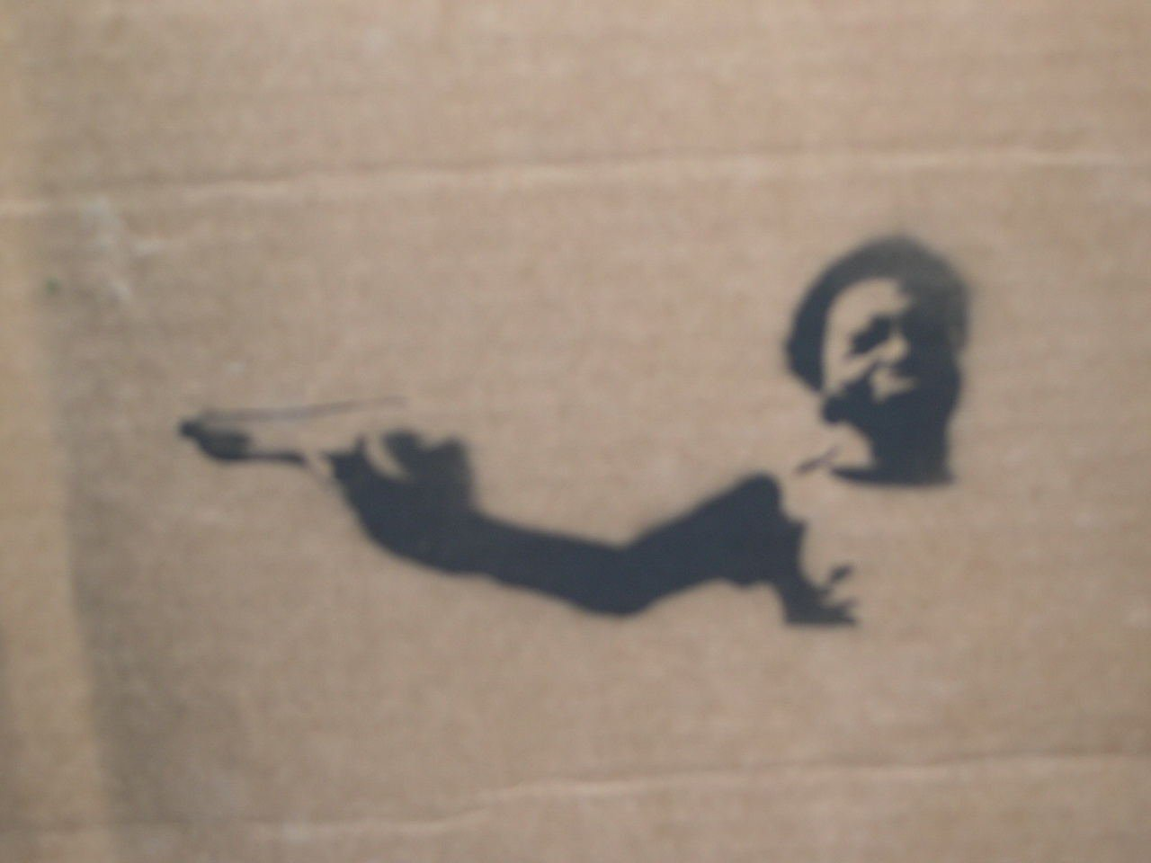 stencil of kid from the movie city of god