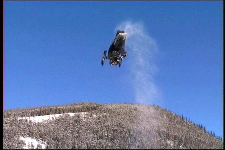 jay quinlan doin a backflip on his snowmobile