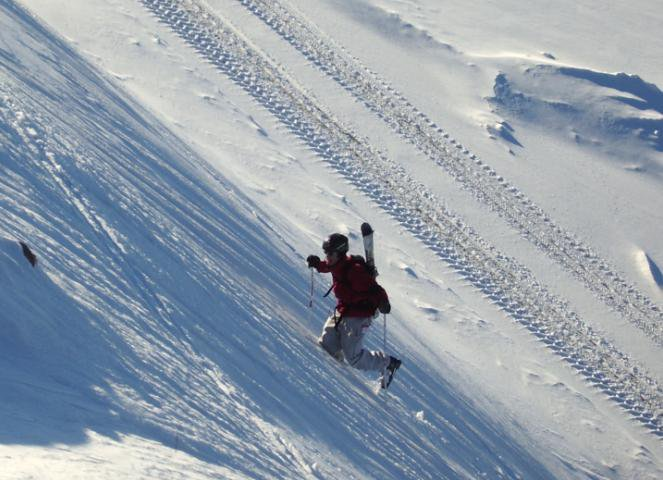 hauling-ass up some wind-packed powder
