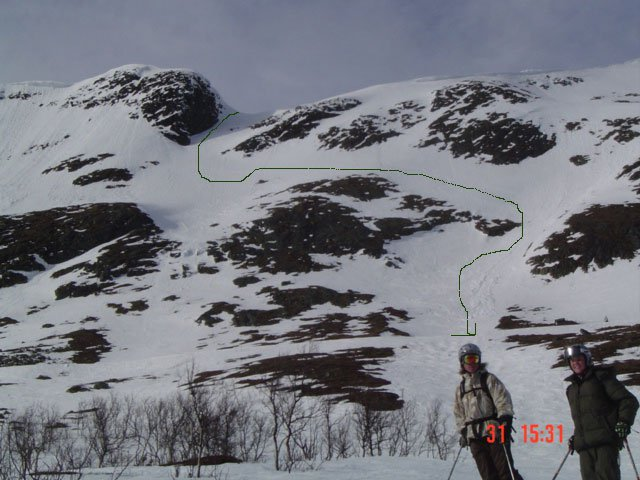 The line from below. I was the first to hike it and ski it in months. A lot steeper than it looks.