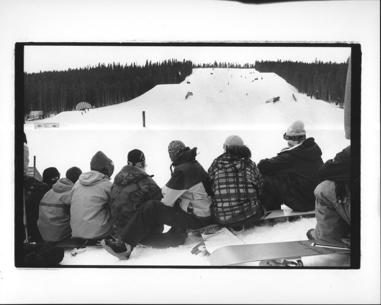 crowd on top of the quarterpipe watching the park