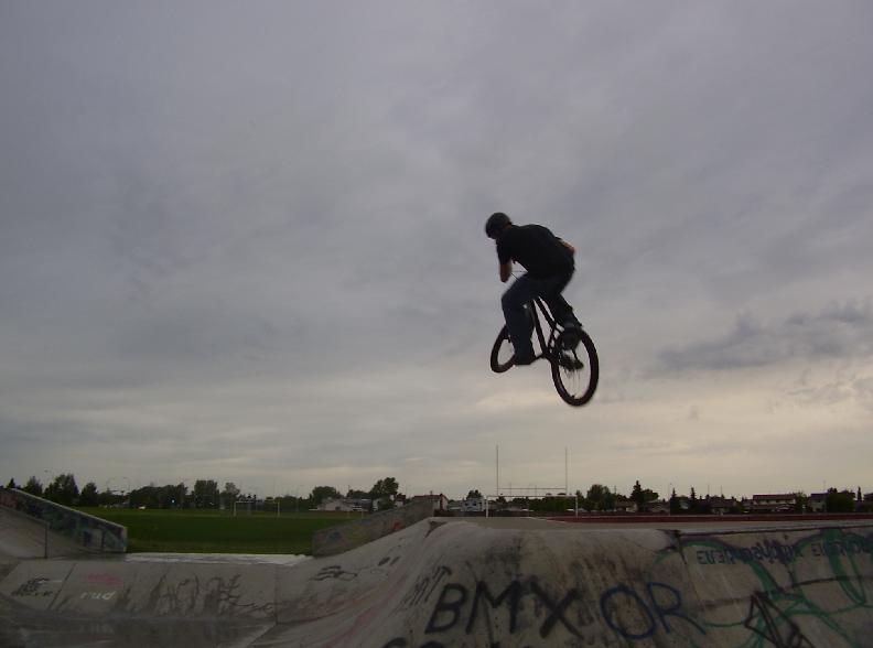 biker goin big in the rain