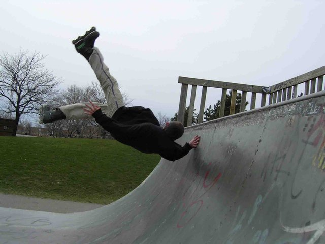 rollerblade in the half-pipe