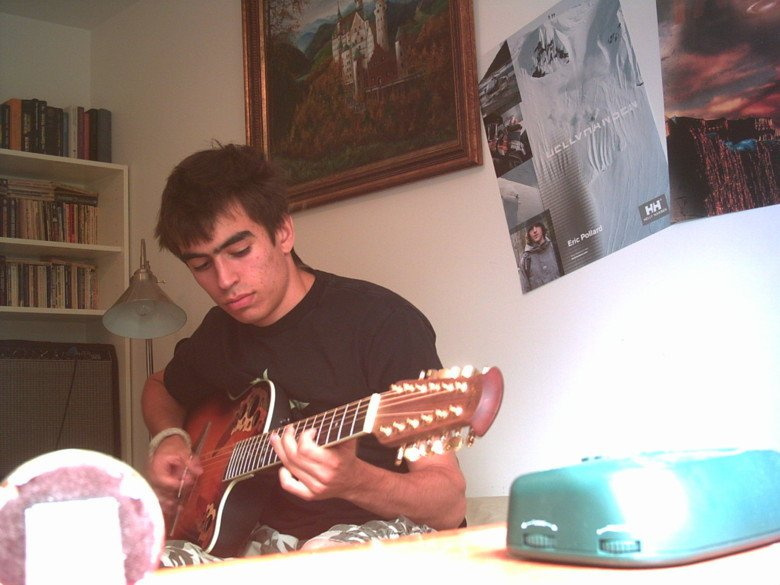 lookin' like a mess while playin' the guitar