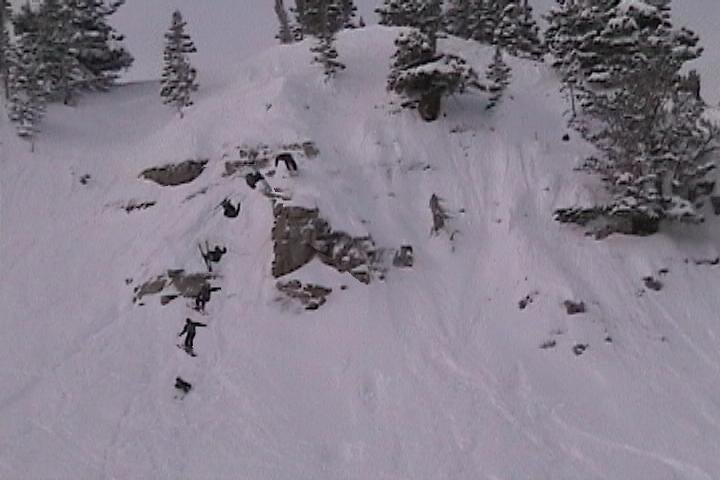 Eric doing a front flip over last chance cliffs at Alta