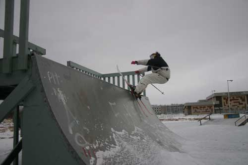 Riding an iced up mini-ramp.