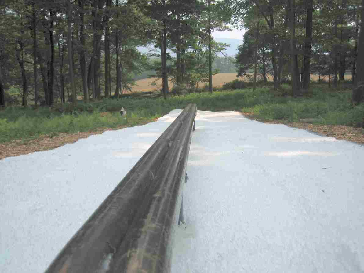 """Backyard Park: Double 1.5"""" 16' long, Blue Mtn in the background"""