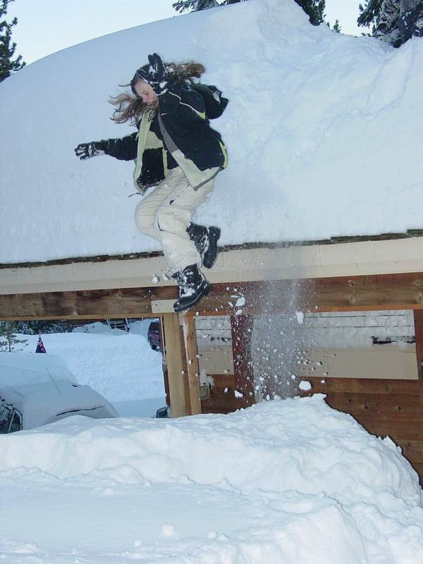 My sis thinkin she's hard core by jumpin off of our roof into like 5 feet of pow.