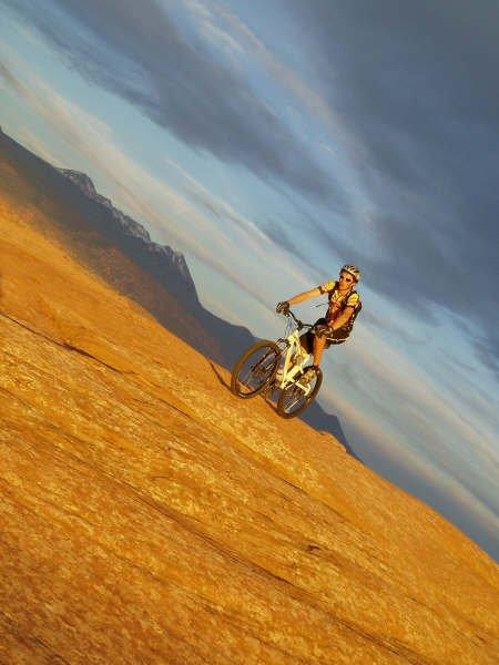 Biking slickrock at sunset