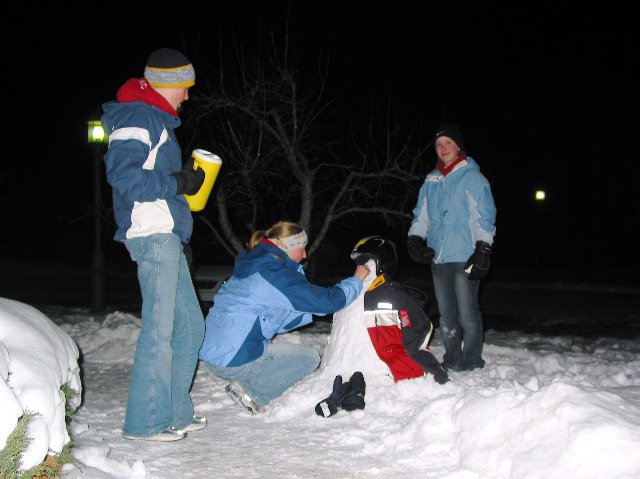 me n the girls making a snowman