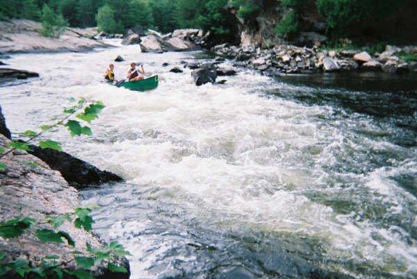 Running some heavy class III in an open canoe...fun.