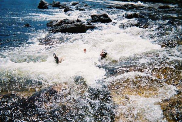 Bodysurfing rapids. Not so smart but fun.
