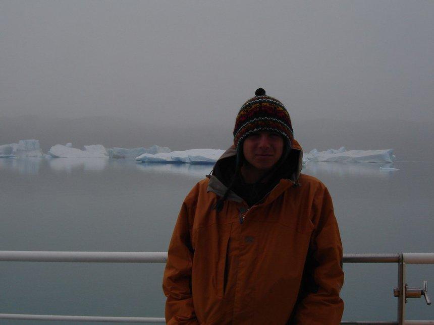 summer, frigid waters and icebergs