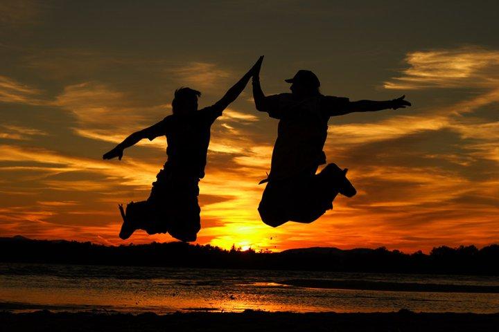 Witt & Lil' John jumping into the sunset