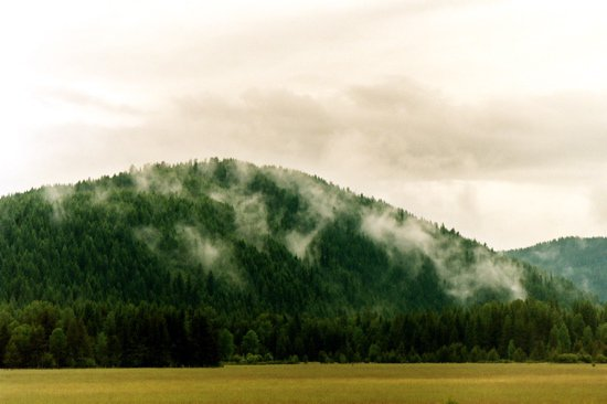 Mountain w/ mist coming off