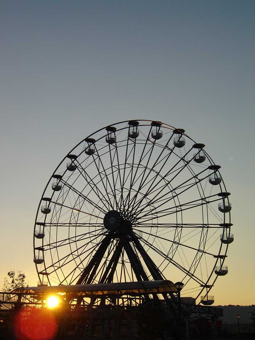 Falling behind the ferris wheel