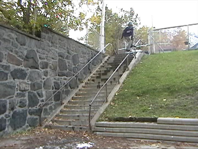 small jump with skier on the rail