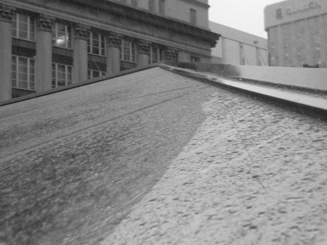 Rain falling on a pyramid window