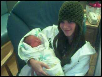 Me and my newborn baby cousin Tavi