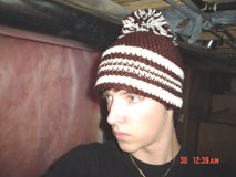 brown n' white hat w/ pom pom
