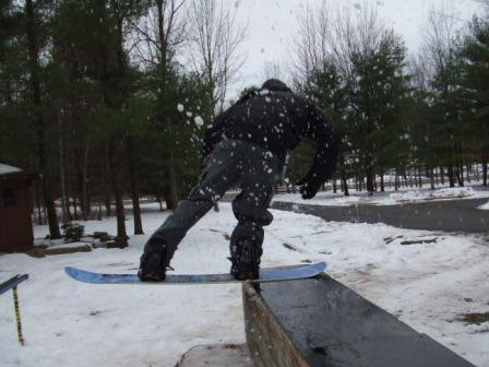 i ski but here's me trying a tail slide on a board