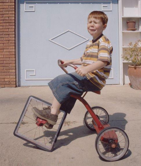 Kid on bike.