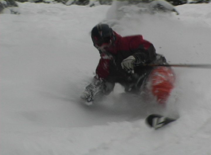 skiing powder without his heels connected