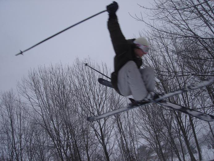 rich grabs his ski as the sky turns grey...