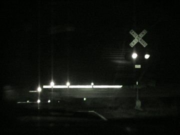 train crossing at night