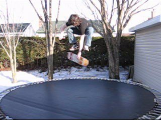 skateboard on trampoline (varial-kick indy)