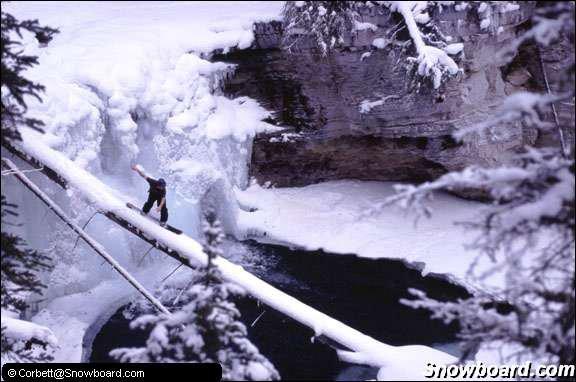 snowboarder log over lake
