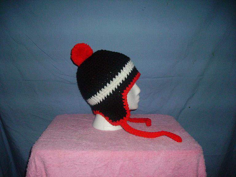 Black white and red earflap beanie